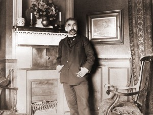 Mallarme standing in front of his portrait by Manet