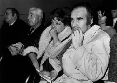 Jacques Prevert, who, besides being a poet, was a prolific screenwriter, in a screening room with Simone Signoret and Michel Piccoli.