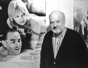 Makavejev with a poster of his film