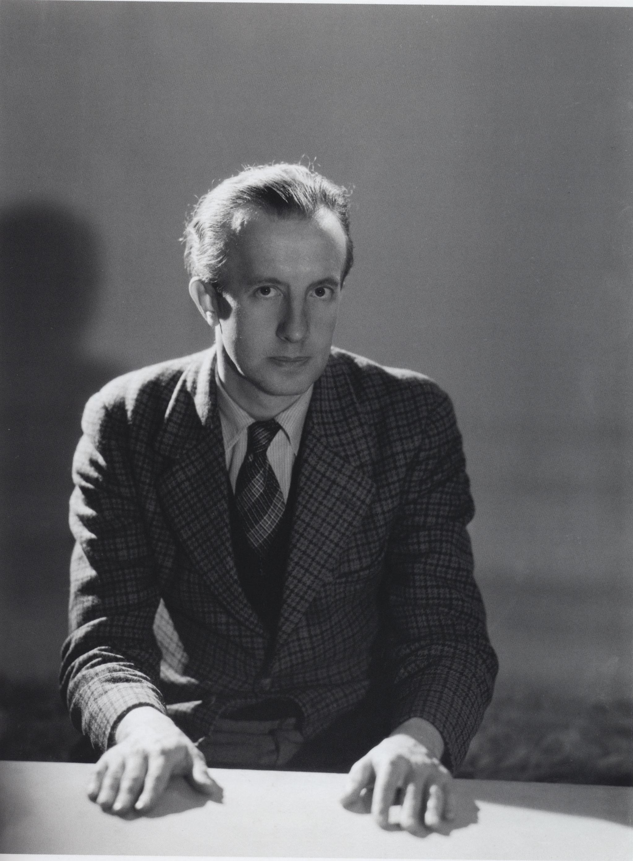 Paul Eluard looking into the camera.
